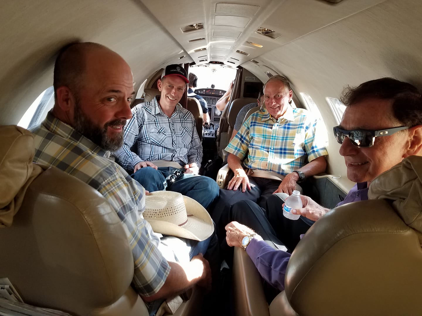 From his nonprofit's Facebook page (Protect the Harvest). Oil man Lucas gives pardoned arsonists Steven and Dwight Hammond a ride home to Burns, Ore. … in his company's private jet.